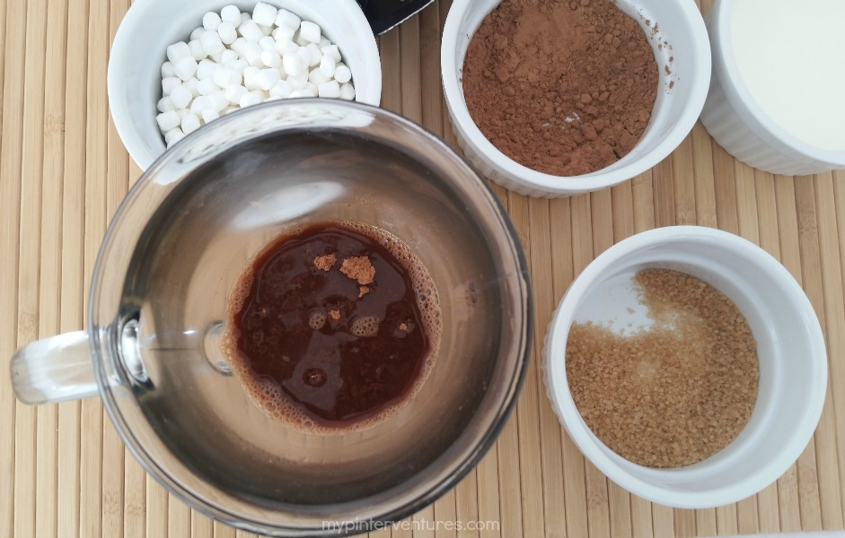 Mixing in the cocoa for money saving homemade mocha coffee