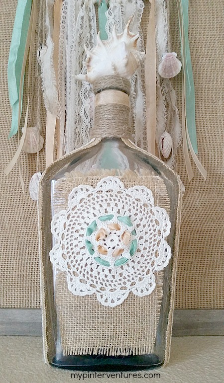 Seashell bottle with vintage doily