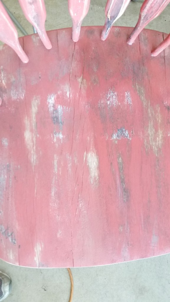 Wax on red weathered chair