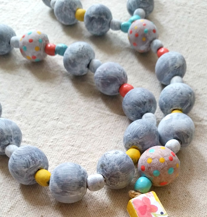 Colorful wood painted rosary close-up