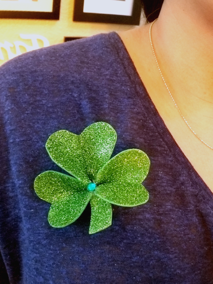 Shamrock pin pinned onto blue shirt