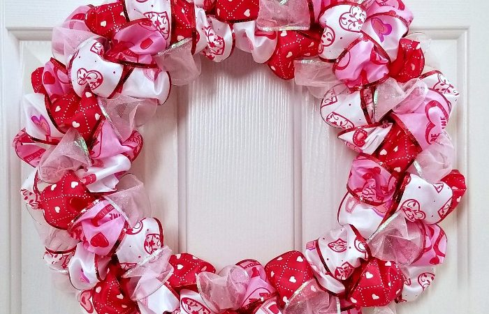 Valentine's Day Ribbon Loop Wreath hanging on door
