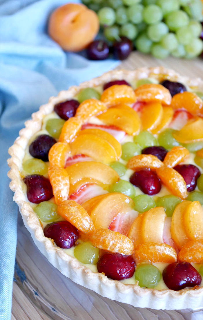 Fresh Fruit Tart with Orange Curd - fresh cherries, grapes, apricots, strawberries, and mandarin oranges top the tart.