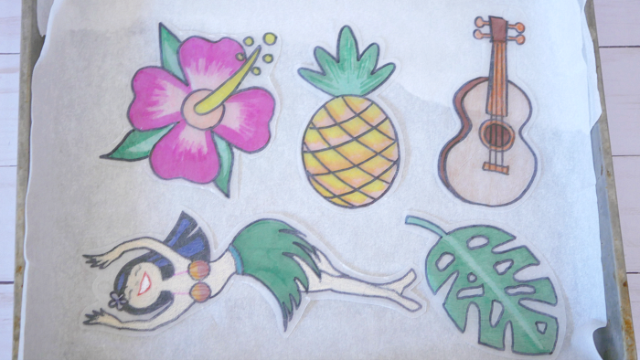 Tropical Shrinky Dinks on baking pan with parchment paper