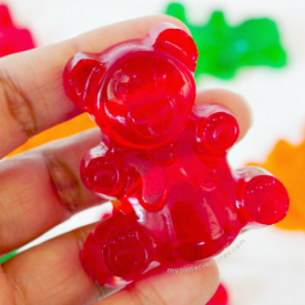 Jumbo Jello Gummy Bear in hand