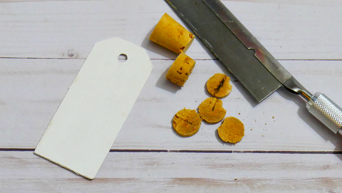 Paint wood tags and cut corks