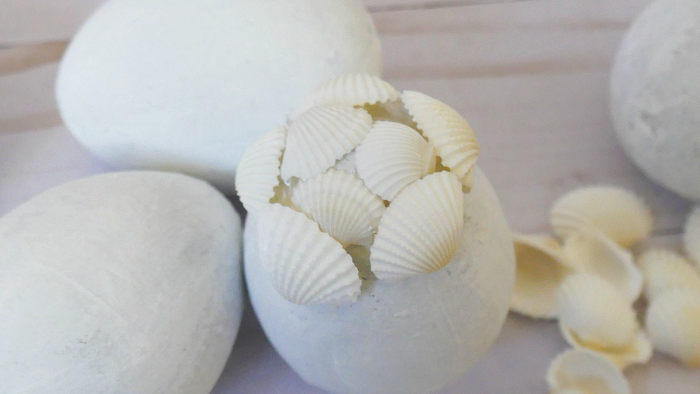 seashell application to painted paper mache egg