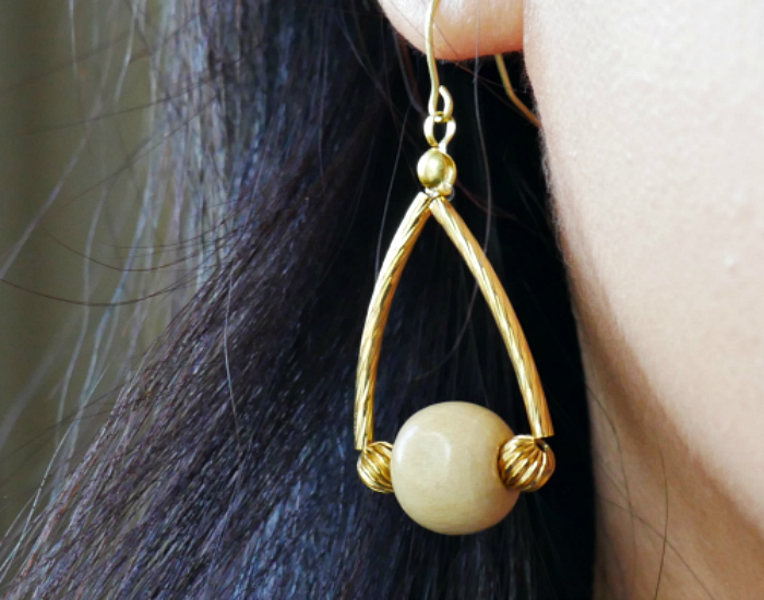 closeup of wooden bead dangle earrings