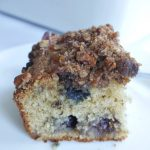 blueberry coffee cake slice on white plate