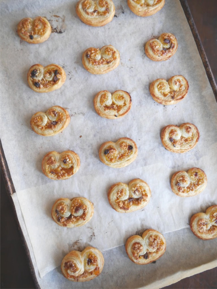 Baked granola fruit palmiers on baking sheet