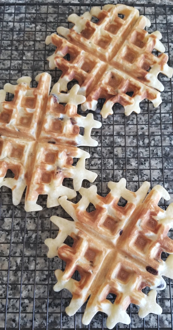 Cooling chocolate chip mochi waffles on baking rack