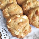 White chocolate macadamia nut cookies on white plate