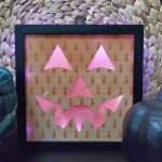 Lit pumpkin face shadow box