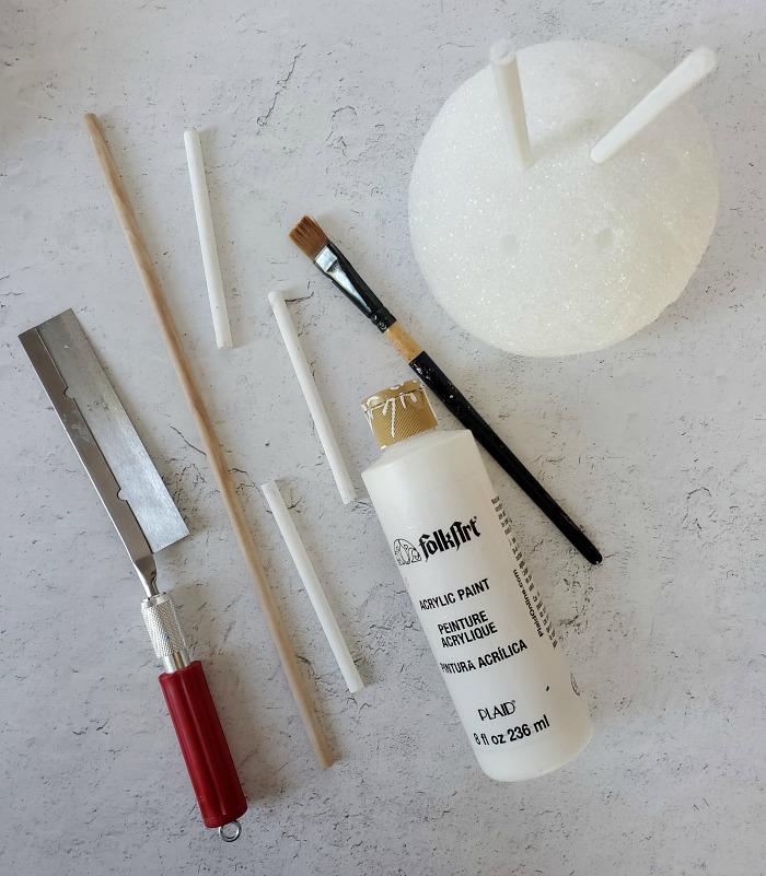 Cut animal crossing balloon present ornatmentsdowels and paint white