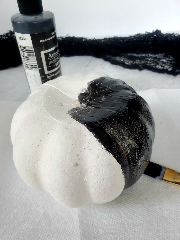Painting foam pumpkin black