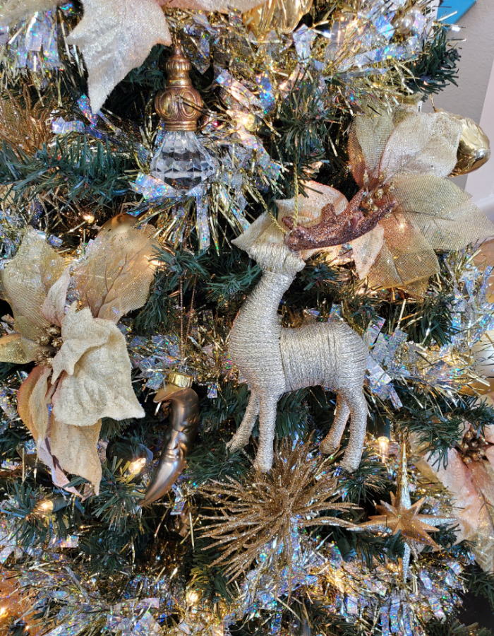 Closeup of the gold holographic garland Christmas tree